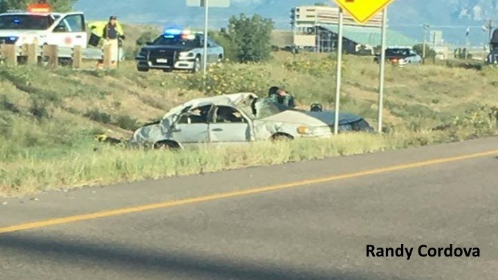 Rollover crash on I-25 (Photo: Randy Cordova)