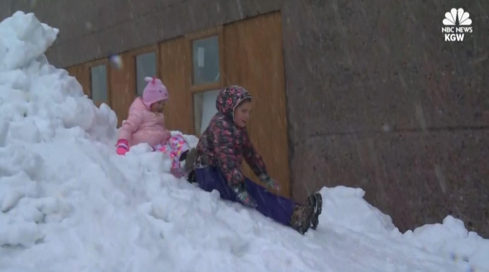 Kids play in the snow near Mount Hood in Oregon.