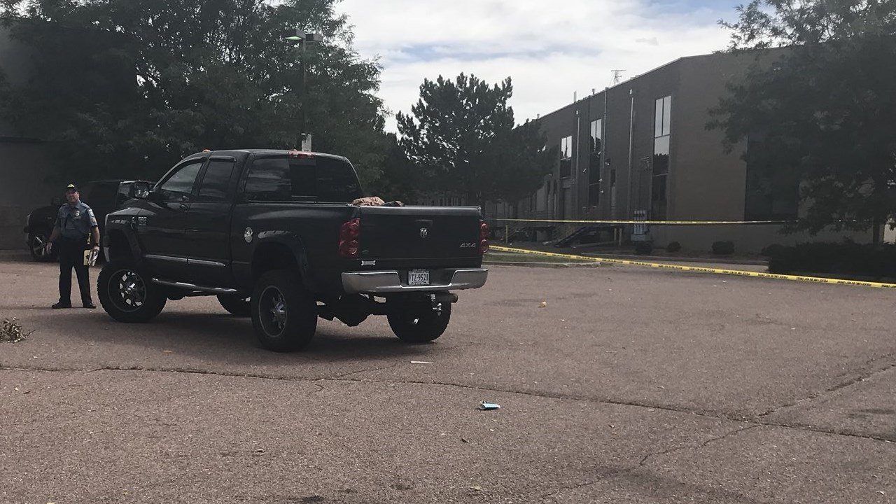 An officer near the scene of a shooting across the street from Doherty High School. (KOAA)