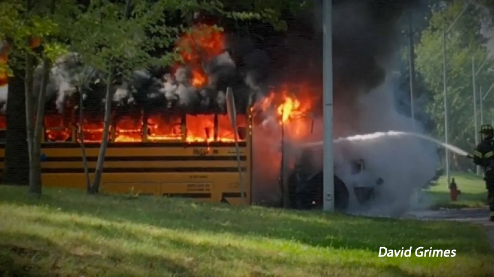 Driver pulls students from burning bus.