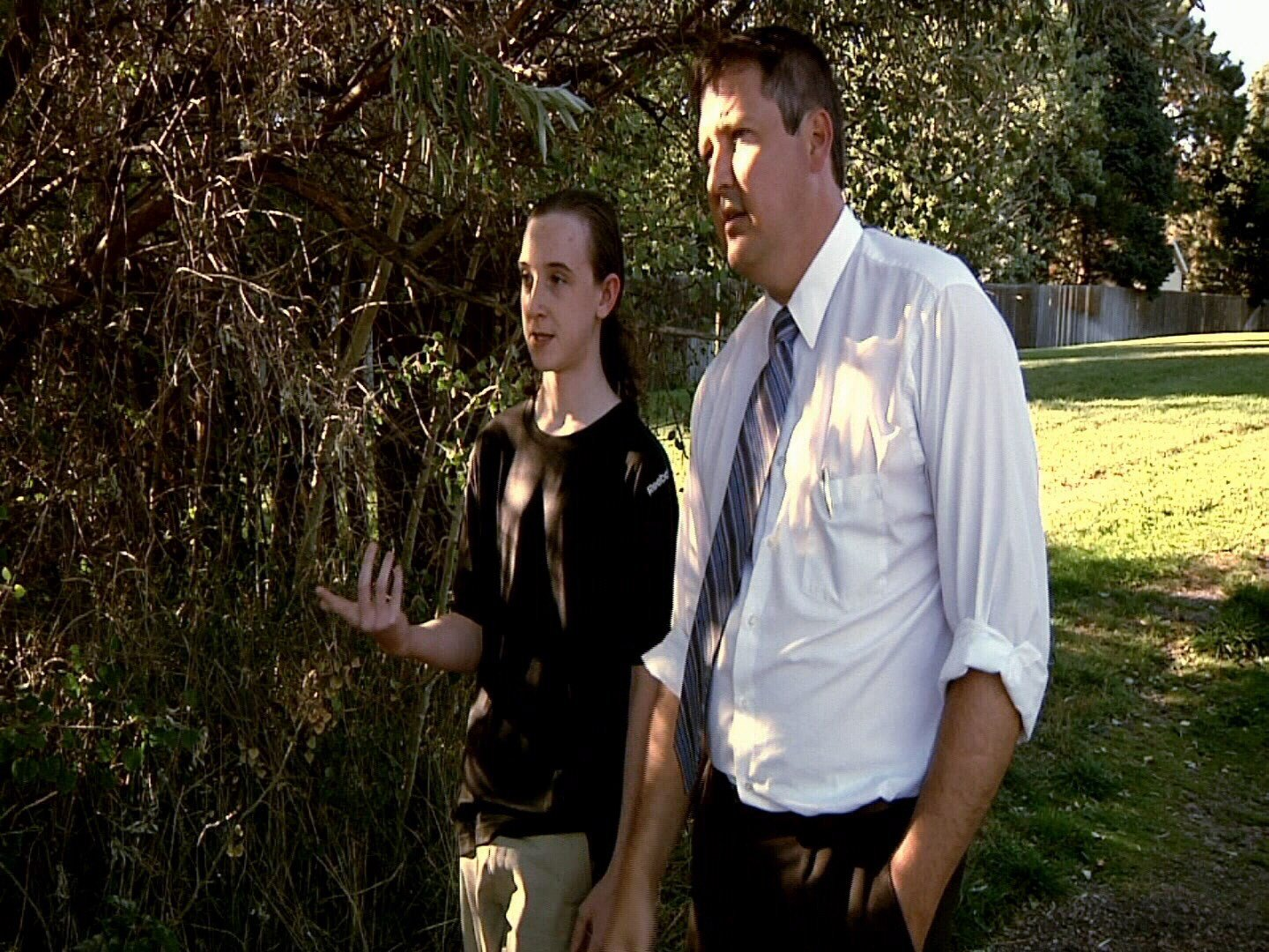 Brendan Johnson, 13, shows reporter Andy Koen the spot where he was ambushed and had his bicycle stolen two weeks ago