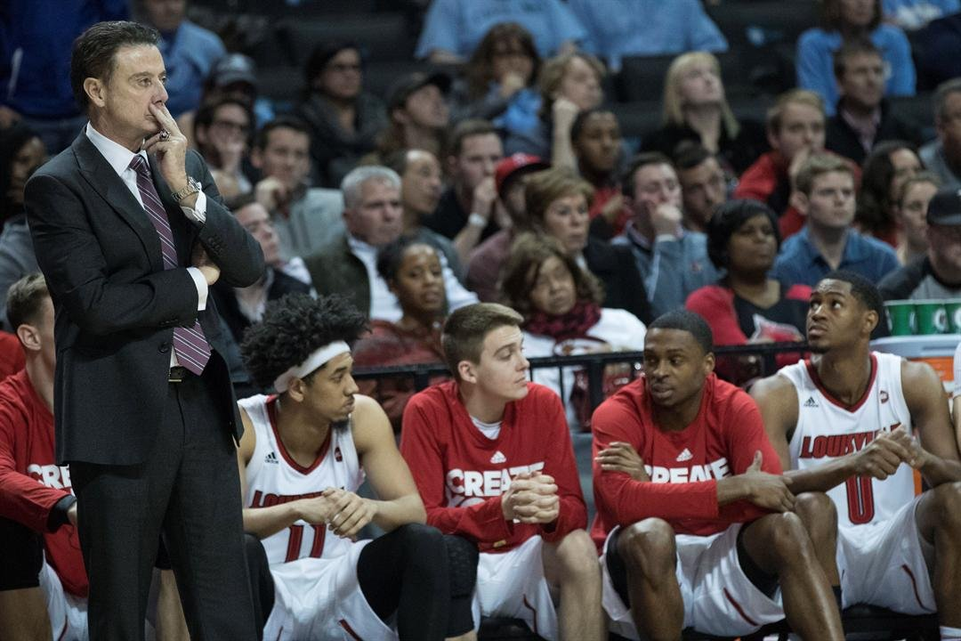 Louisville head coach Rick Pitino, left, watches the action during the second half of an NCAA college basketball game against Louisville in the Atlantic Coast Conference tournament, Thursday, March 9, 2017, in New York. Duke won 81-77.