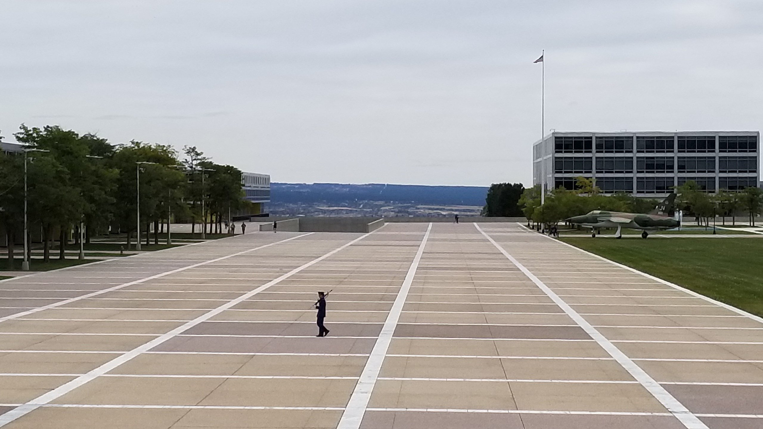 A uniformed sentry paces the Terrazo at the US Air Force Academy