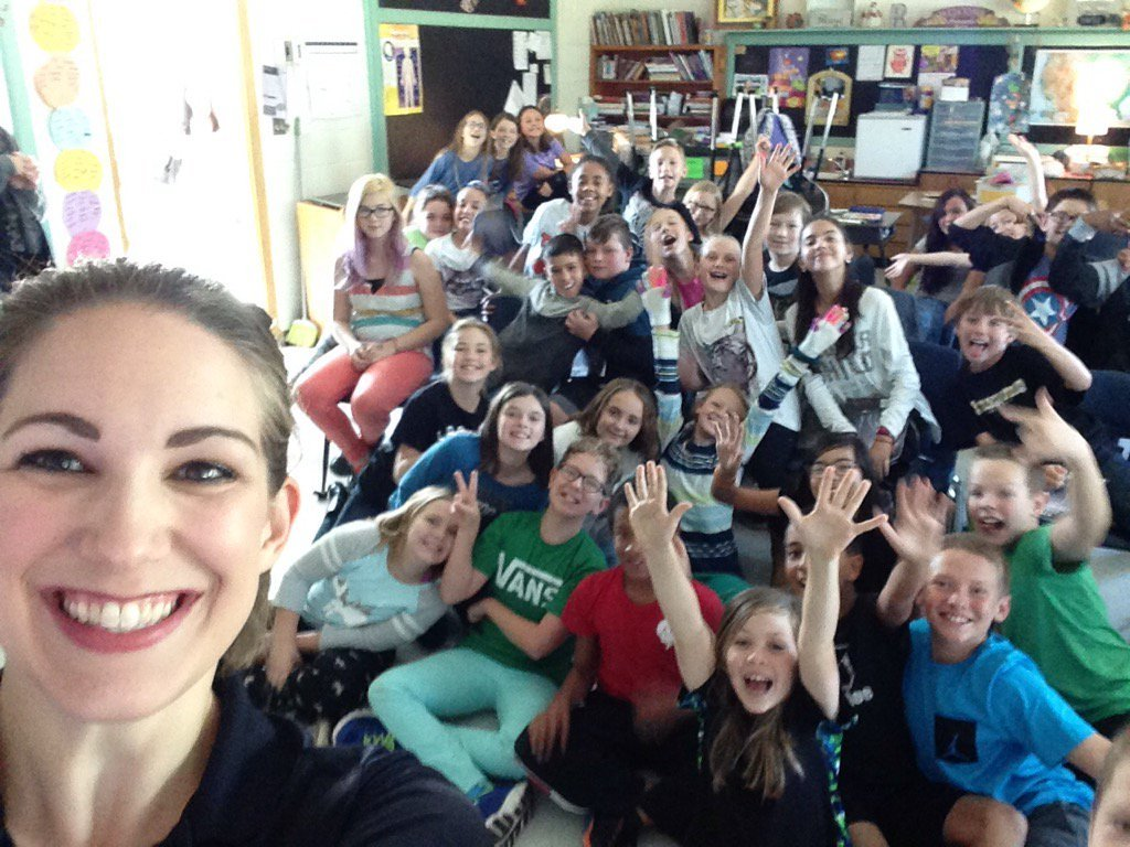 Jessica Van Meter poses with fifth graders at Taylor Elementary School after a storm safe visit on Oct. 11, 2017.