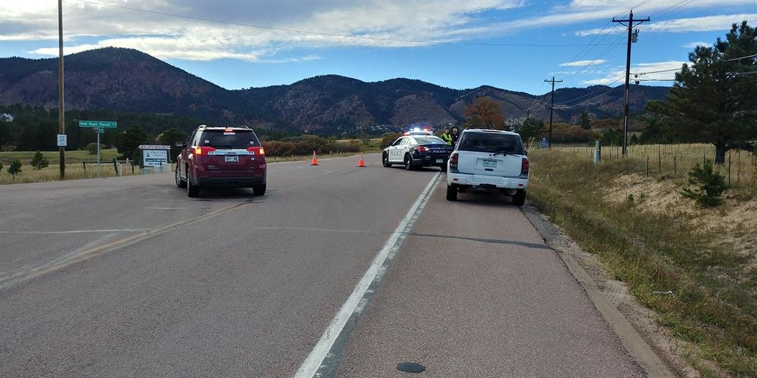 A injury crash involving a motorcycle and two cars has shut down Highway 105 near Palmer Lake on Oct. 11, 2017.