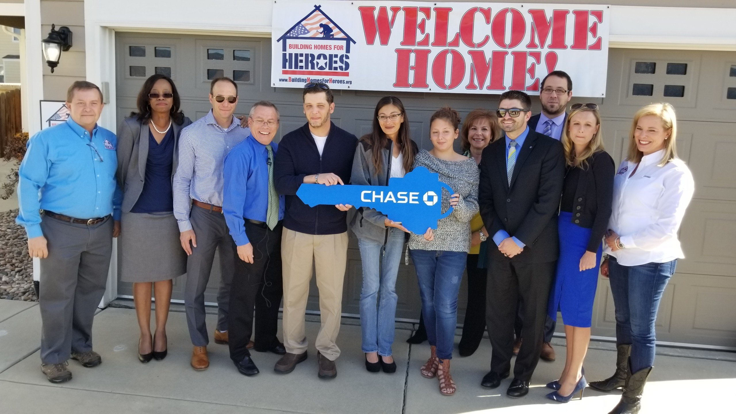 A wounded veteran receives a home in Colorado Springs on Oct. 19, 2017.