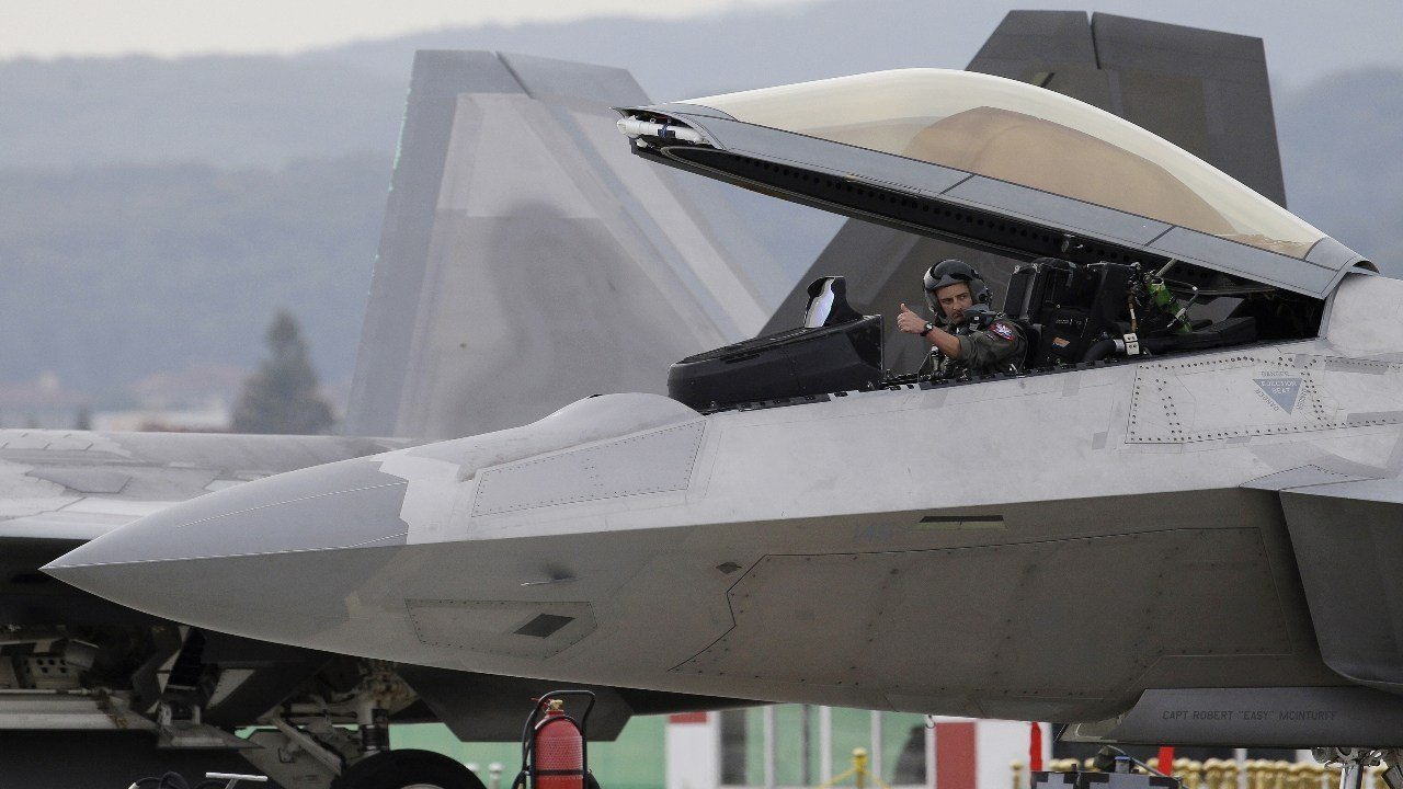 U.S. Air Force Maj. Rock Dickinson gestures in his F-22 stealth fighter before taking off during the press day of the 2017 Seoul International Aerospace and Defense Exhibition at Seoul Airport in Seongnam, South Korea, Monday, Oct. 16, 2017. (AP Photo)