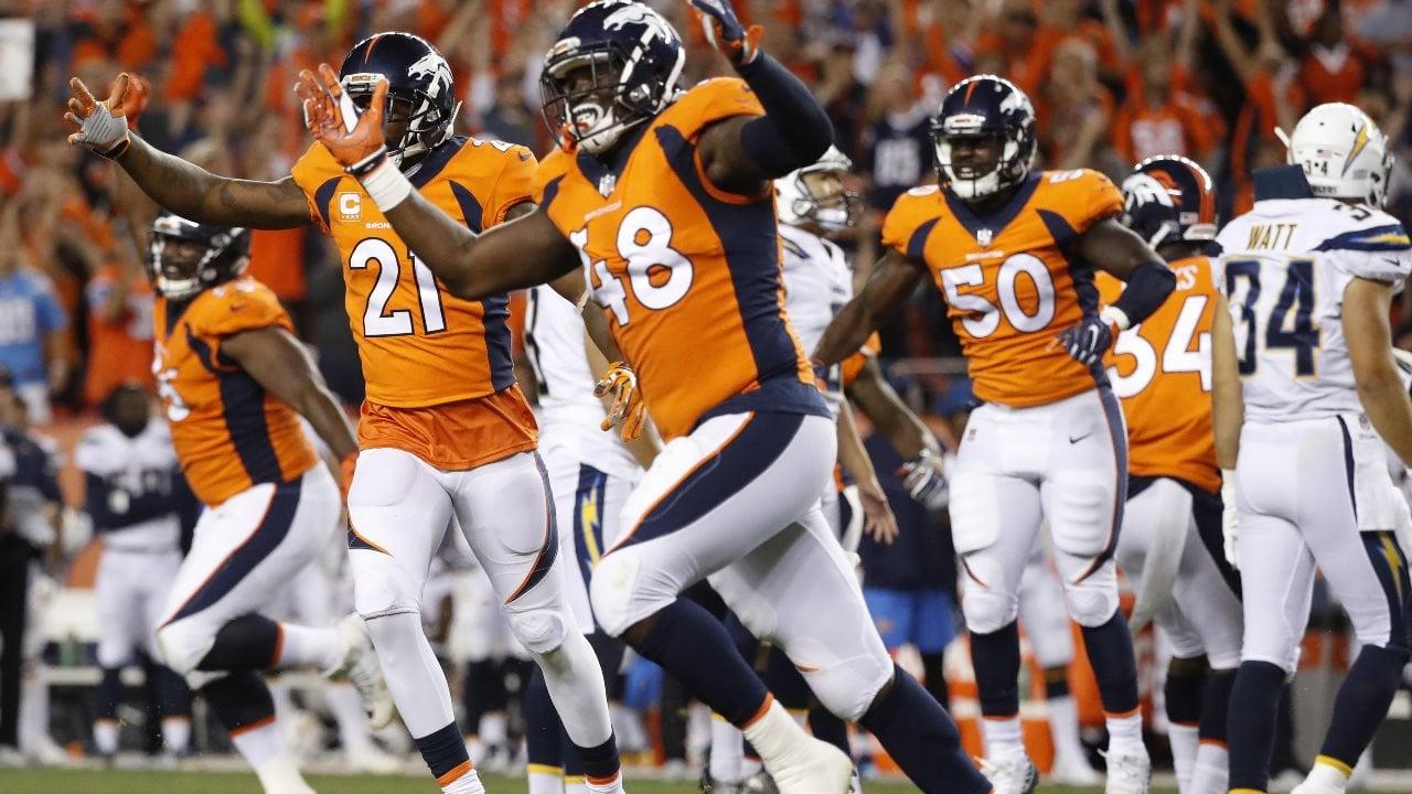 Denver Broncos outside linebacker Shaquil Barrett (48), cornerback Aqib Talib (21) and inside linebacker Zaire Anderson (50) (Monday, Sept. 11, 2017 -  AP Photo/Jack Dempsey)