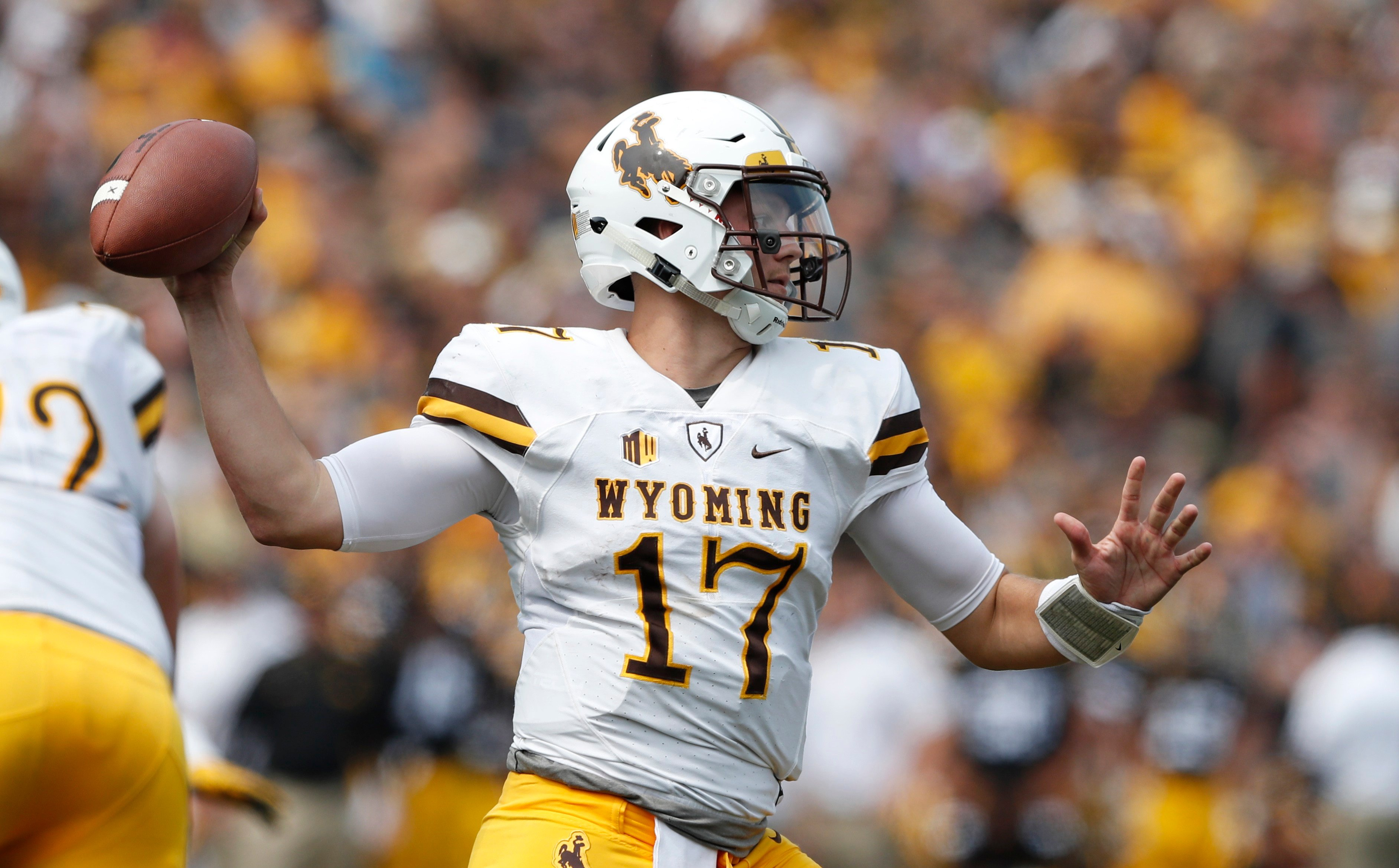 Wyoming quarterback Josh Allen throws a pass during the second half of an NCAA college football game against Iowa, Saturday, Sept. 2, 2017, in Iowa City, Iowa. Iowa won 24-3.