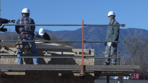 Cadets with the Air Force Academy volunteered their time with Habitat for Humanity Saturday