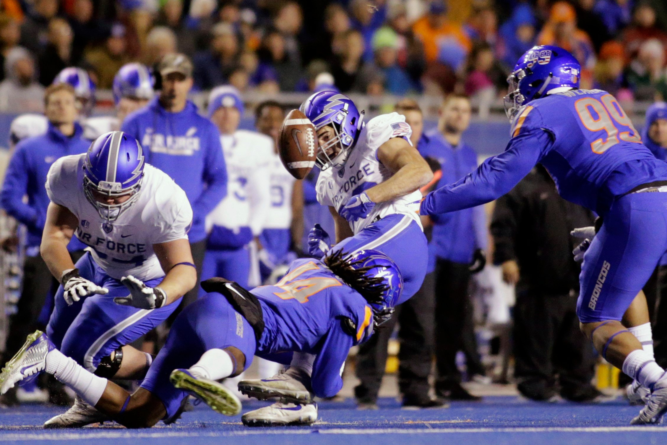 Air Force running back Tim McVey (33) fumbles the ball on a tackle by Boise State cornerback Tyler Horton (14) during the first half of an NCAA college football game in Boise, Idaho, Saturday, Nov. 18, 2017.