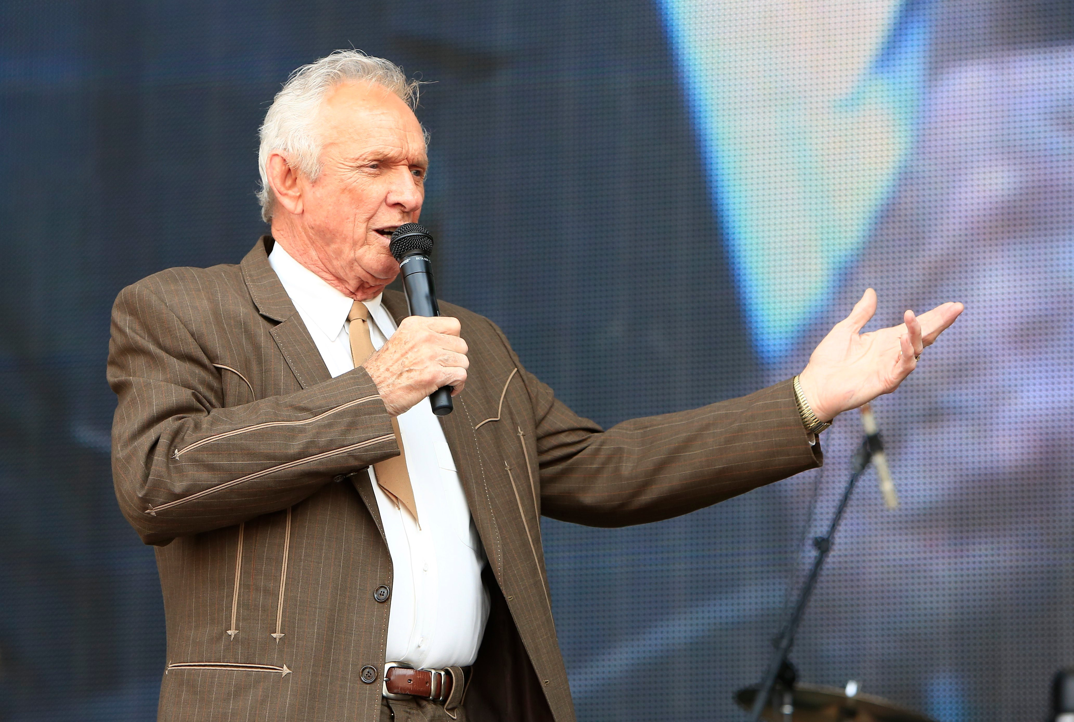 Mel Tillis performs at the Oklahoma Twister Relief Concert at the Gaylord Family-Oklahoma Memorial Stadium on Saturday, July 6, 2013 in Norman, Okla.