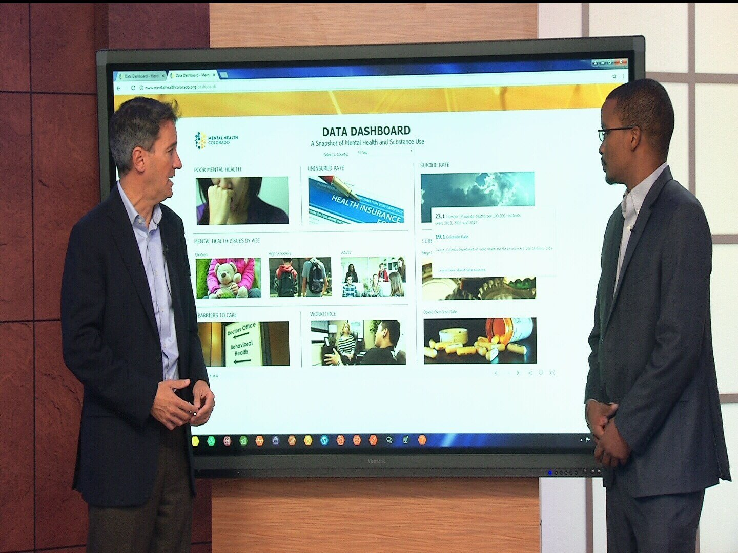 Mental Health Colorado President and CEO Andrew Romanoff, left, and Pikes Peak Regional Coordinator Anderson Miller, right, demonstrate their new data dashboard