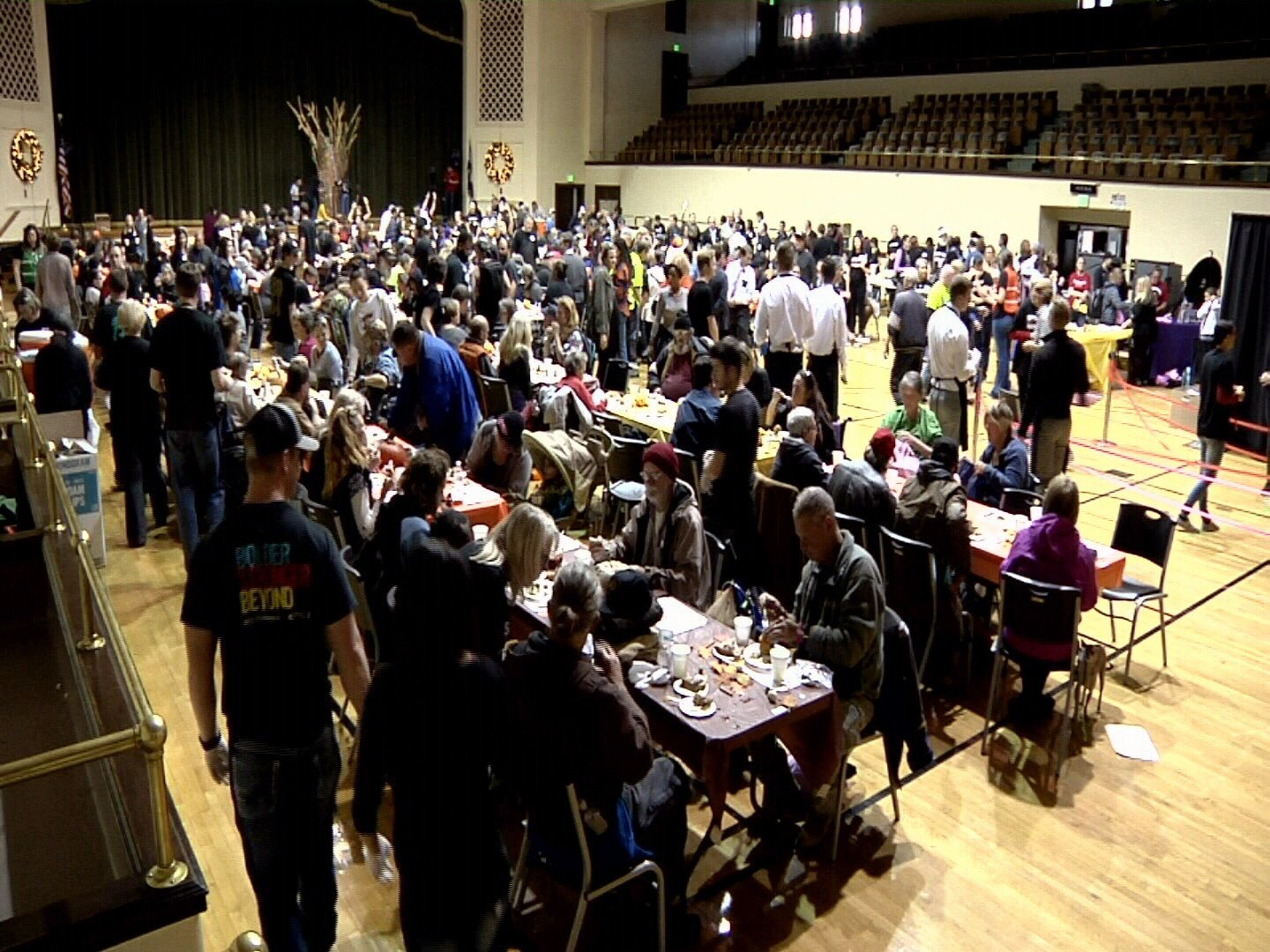 Volunteers servers attend to the estimated 1,000 guests who attended the Springs Rescue Mission Thanksgiving meal