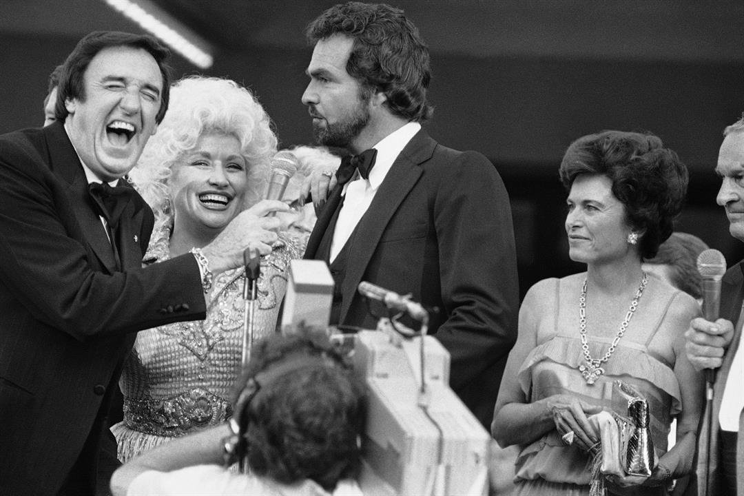 Jim Nabors, Dolly Parton, and Burt Reynolds, left to right, during a gala movie premier in Austin Texas, on Sunday, July 11, 1982. Nabors passed away Nov. 30, 2017.