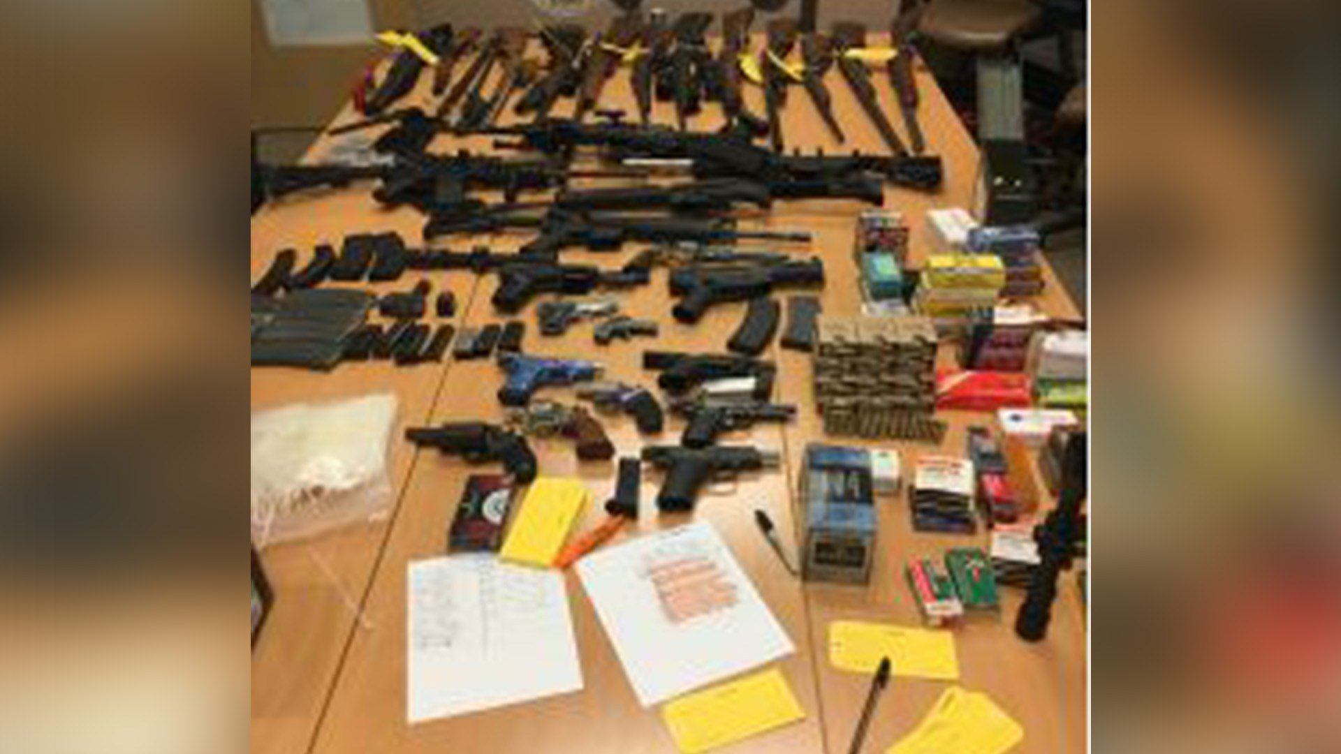 29 guns were seized in a search of a home in Pueblo.