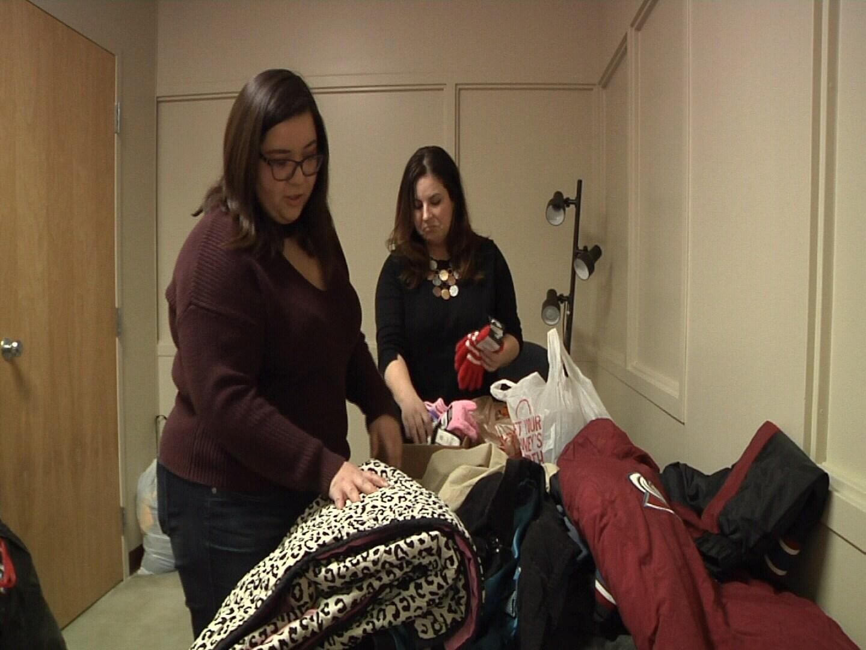 Student Alyssa Vargas-Lopez & Assistant Professor Jennifer Schlosser sort donations