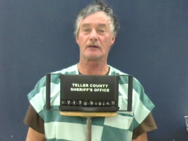 Richard Fretterd turned himself into the Teller County Sheriff's Office late Wednesday night after he was notified of his arrest warrant.