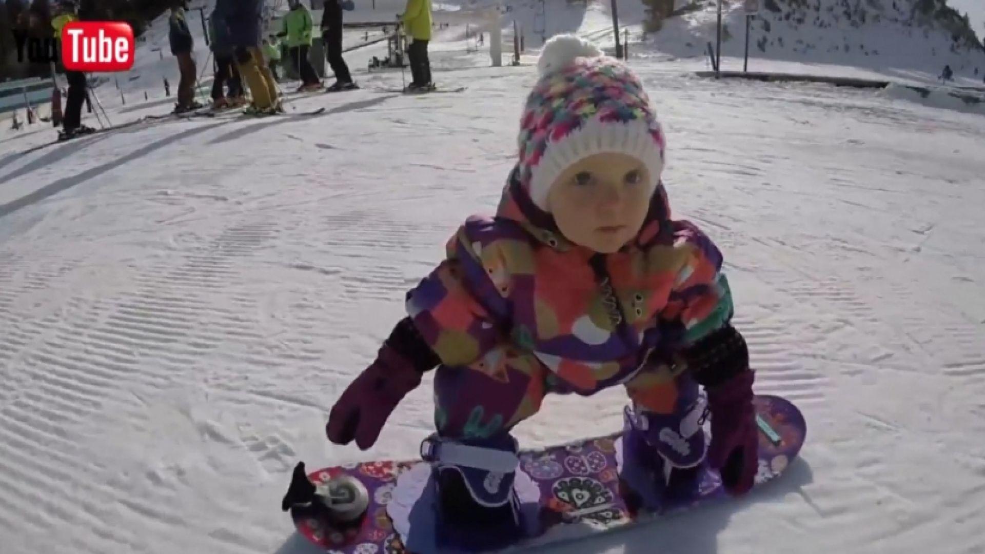 Tiny snowboarder tears up the slopes