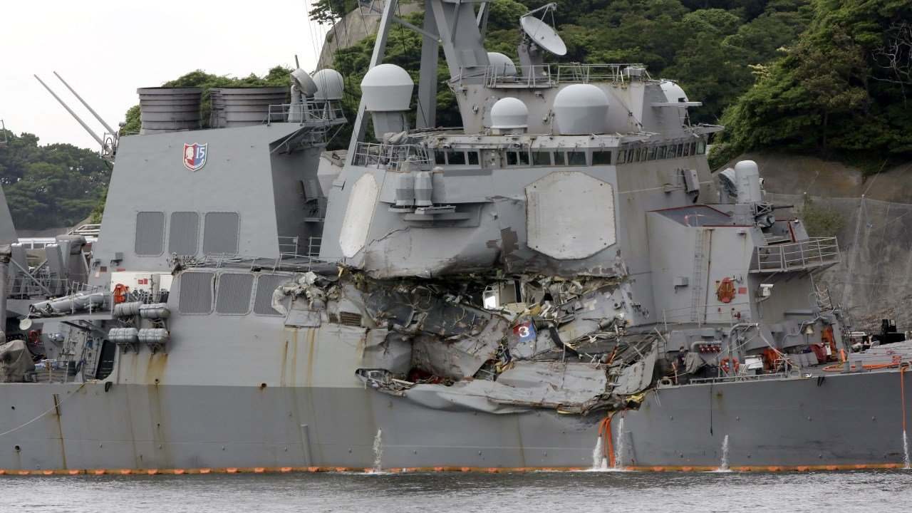 In this Sunday, June 18, 2017, photo, damaged USS Fitzgerald is docked at the U.S. Naval base in Yokosuka, southwest of Tokyo after colliding with Philippine-flagged container ship ACX Crystal off Japan. (AP Images)