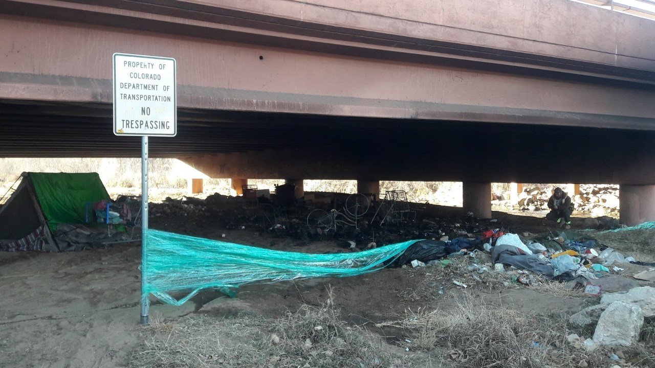 A homeless camp burned beneath Nevada Avenue and I-25 in Colorado Springs. (KOAA)
