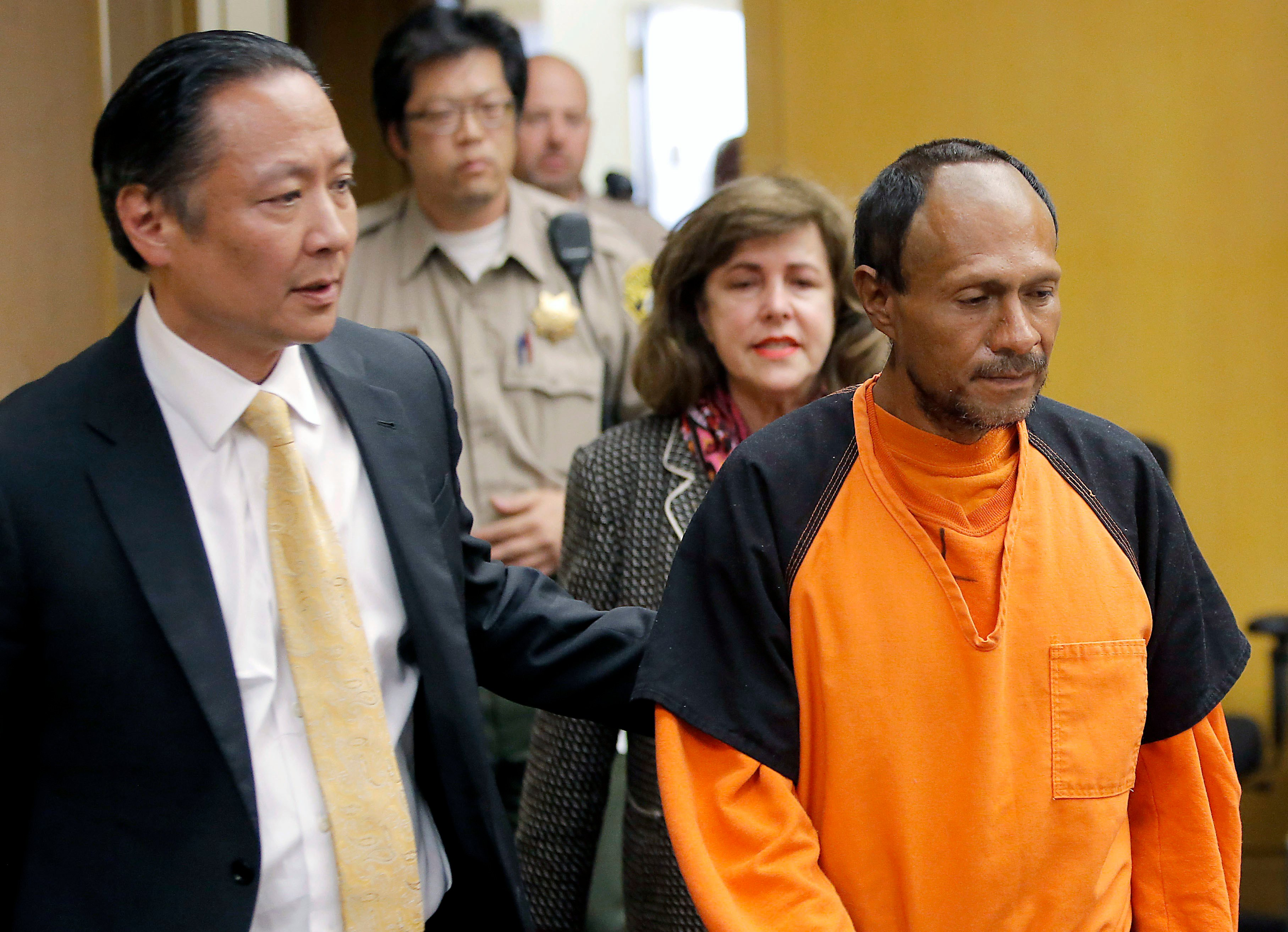 FILE - In this July 7, 2015 file photo, Jose Ines Garcia Zarate, right, is led into the courtroom by San Francisco Public Defender Jeff Adachi, left, and Assistant District Attorney Diana Garciaor, center, for his arraignment.
