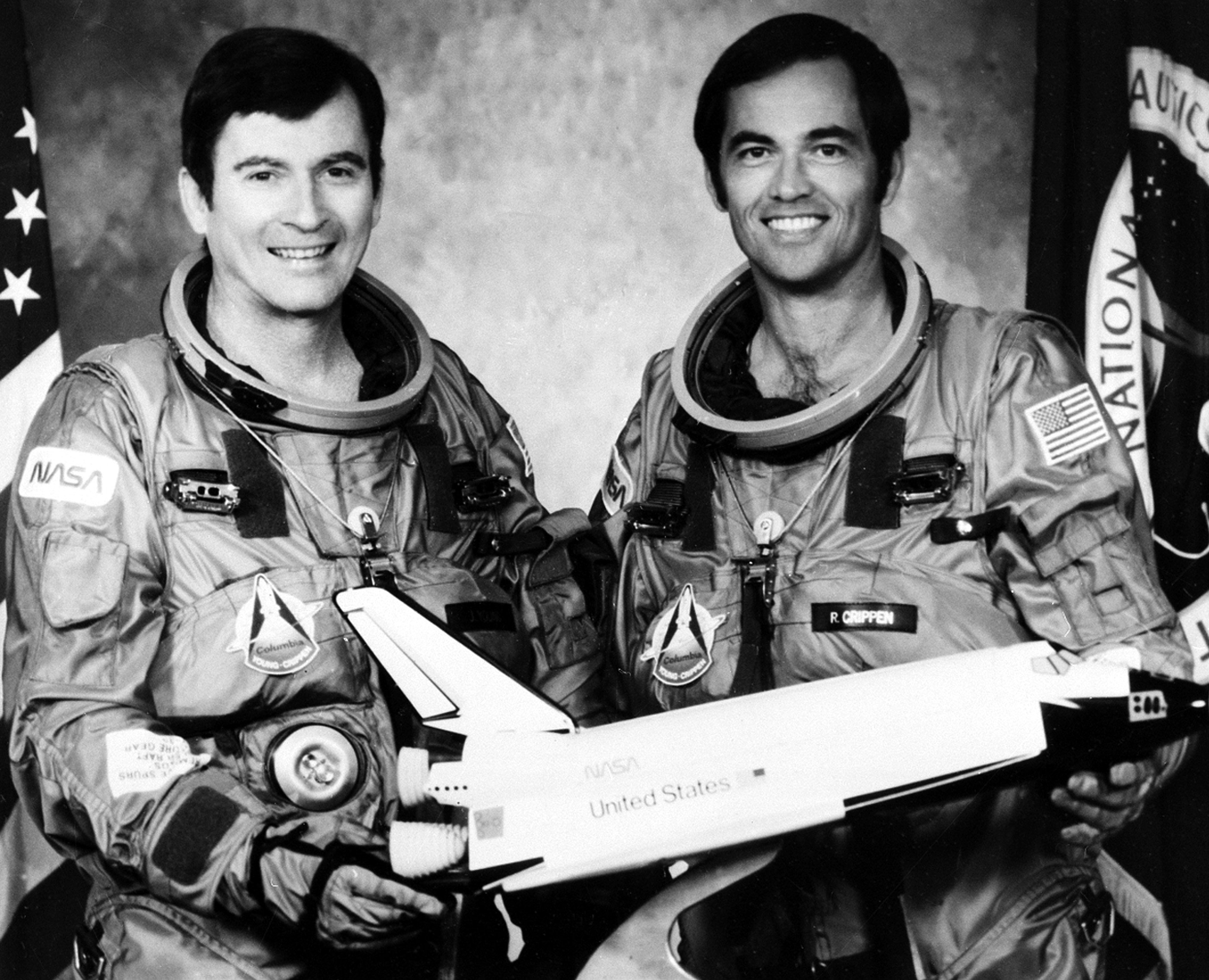 Astronauts John W. Young, left, commander, and Robert L. Crippen, pilot, crew members of the first flight in the Space Transportation System (STS-1) program