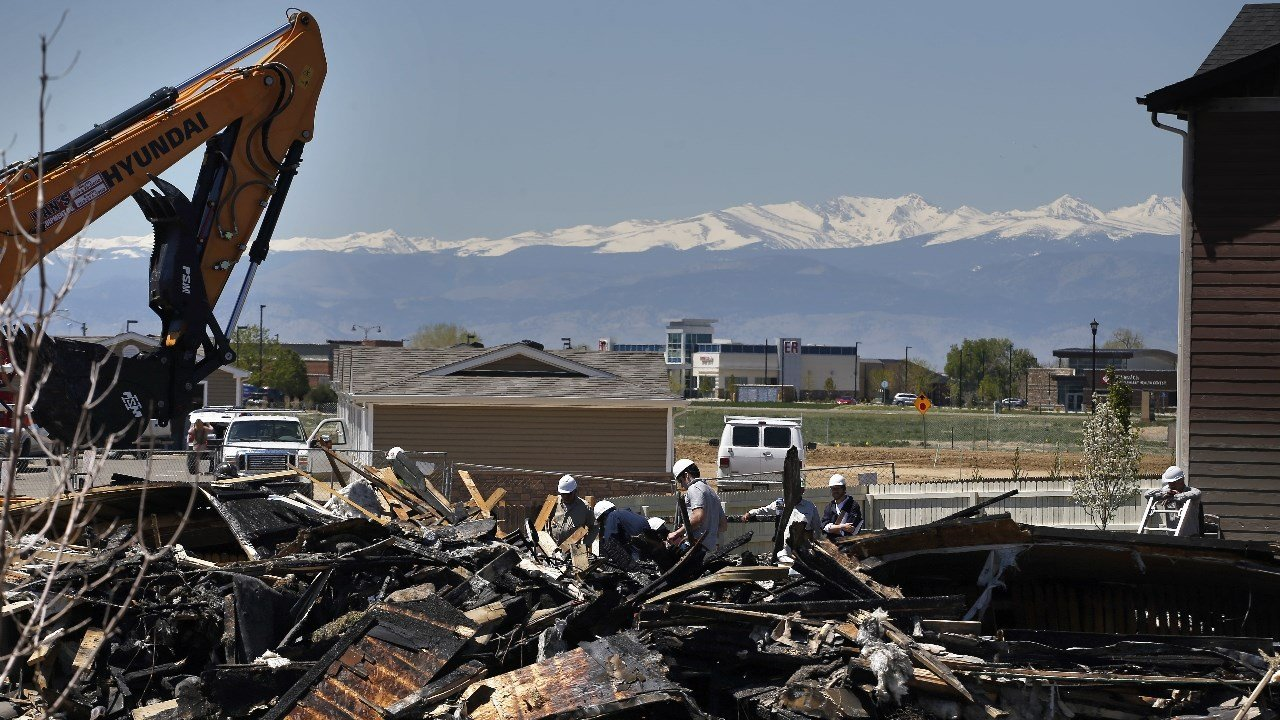 FILE - In this May 4, 2017, file photo, workers dismantle the charred remains of a house where an explosion killed two people in Firestone, Colo.   (AP Photo/Brennan Linsley, File)