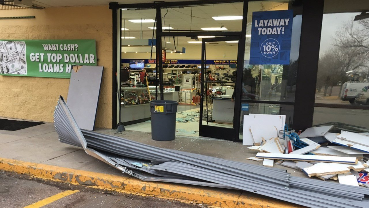 Colorado Springs Police are investigating a crash into EZ Pawn as a burglary. (KOAA)