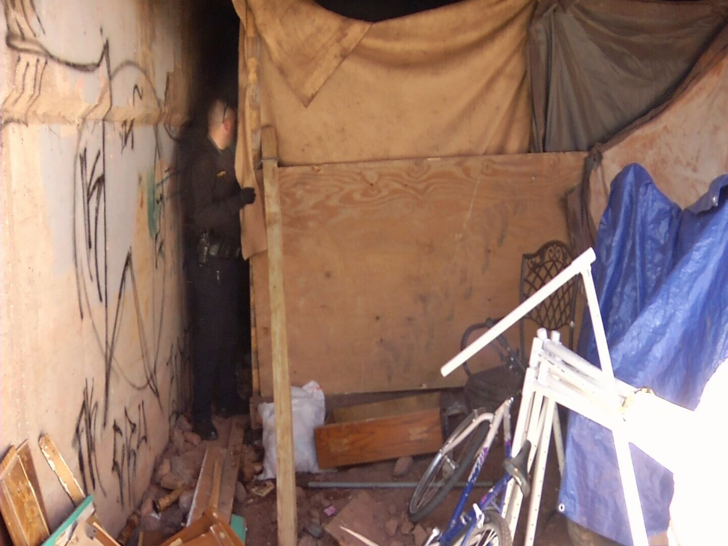 El Paso County Sheriff's Lt. Bill Huffor searches a homeless camp under the bridge at Ridge Road and US HWY 24