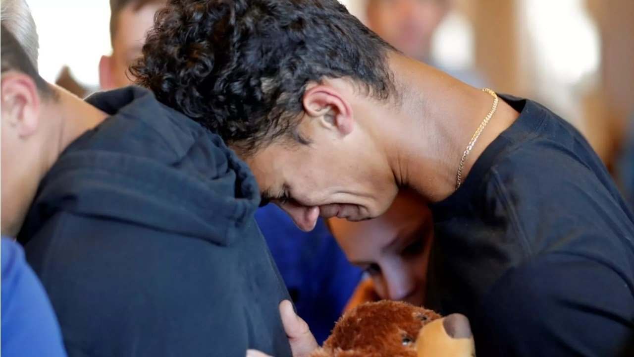 Austin Burden, 17, cries on the shoulder of a friend after a vigil at the Parkland Baptist Church, for the victims of the Wednesday shooting at Marjory Stoneman Douglas High School, in Parkland, Fla., Thursday, Feb. 15, 2018. (AP Photo/Gerald Herbert)