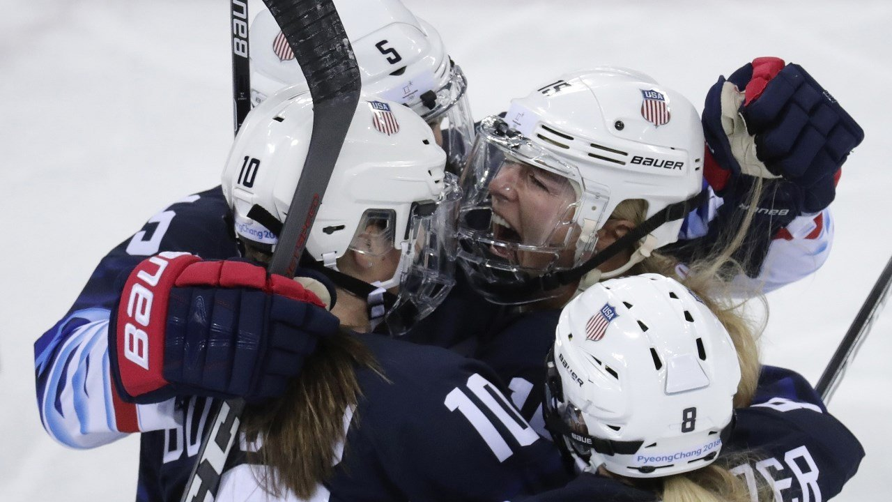 Gigi Marvin (19), of the United States, celebrates with her teammates after scoring a goal against Finland during the first period of the semifinal round of the women's hockey game at the 2018 Winter Olympics (AP Photo/Julio Cortez)