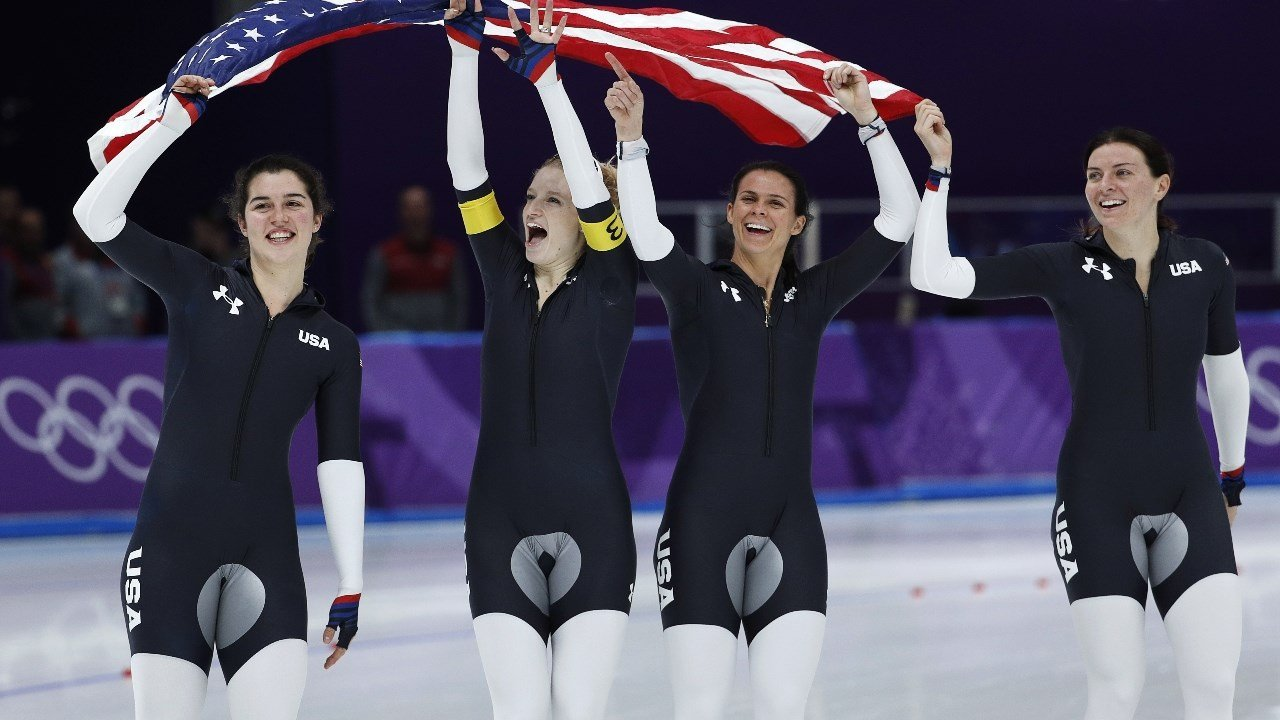 Bronze medalist team U.S.A. with Heather Bergsma, Brittany Bowe, Mia Manganello, and Carlijn Schoutens celebrates after the women's team pursuit final speedskating race at the Gangneung Oval at the 2018 Winter Olympics. (AP Photo/John Locher)