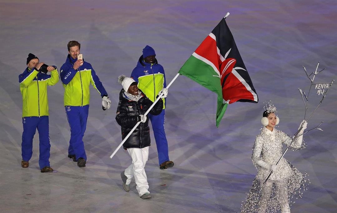 Sabrina Simader carries the flag of Kenya during the opening ceremony of the 2018 Winter Olympics in Pyeongchang, South Korea, Friday, Feb. 9, 2018. (AP Photo/Michael Sohn)