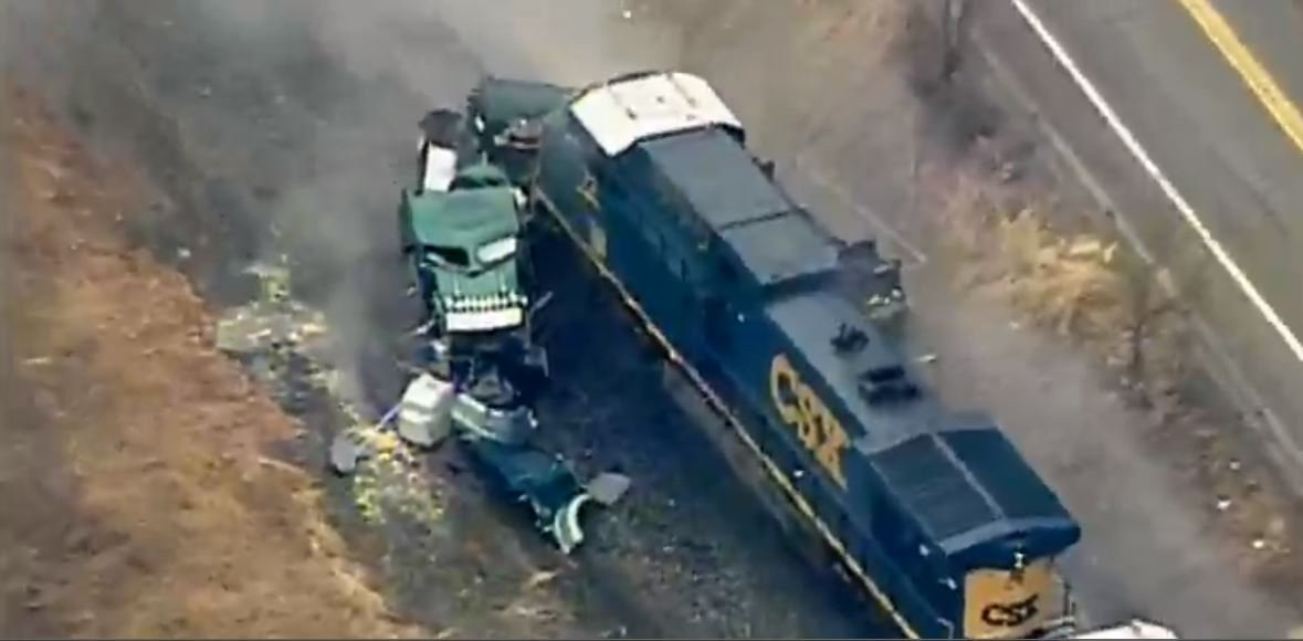 Train hits truck carrying hydrochloric acid in PA
