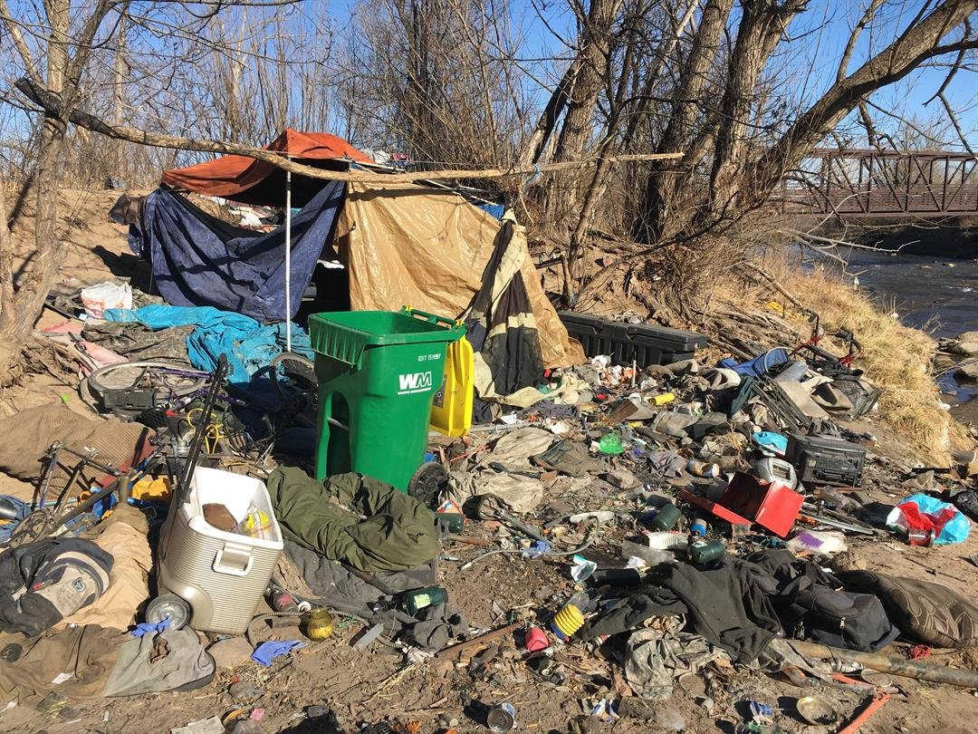 Nearly 100 homeless campers behind Rocky Top Resources.