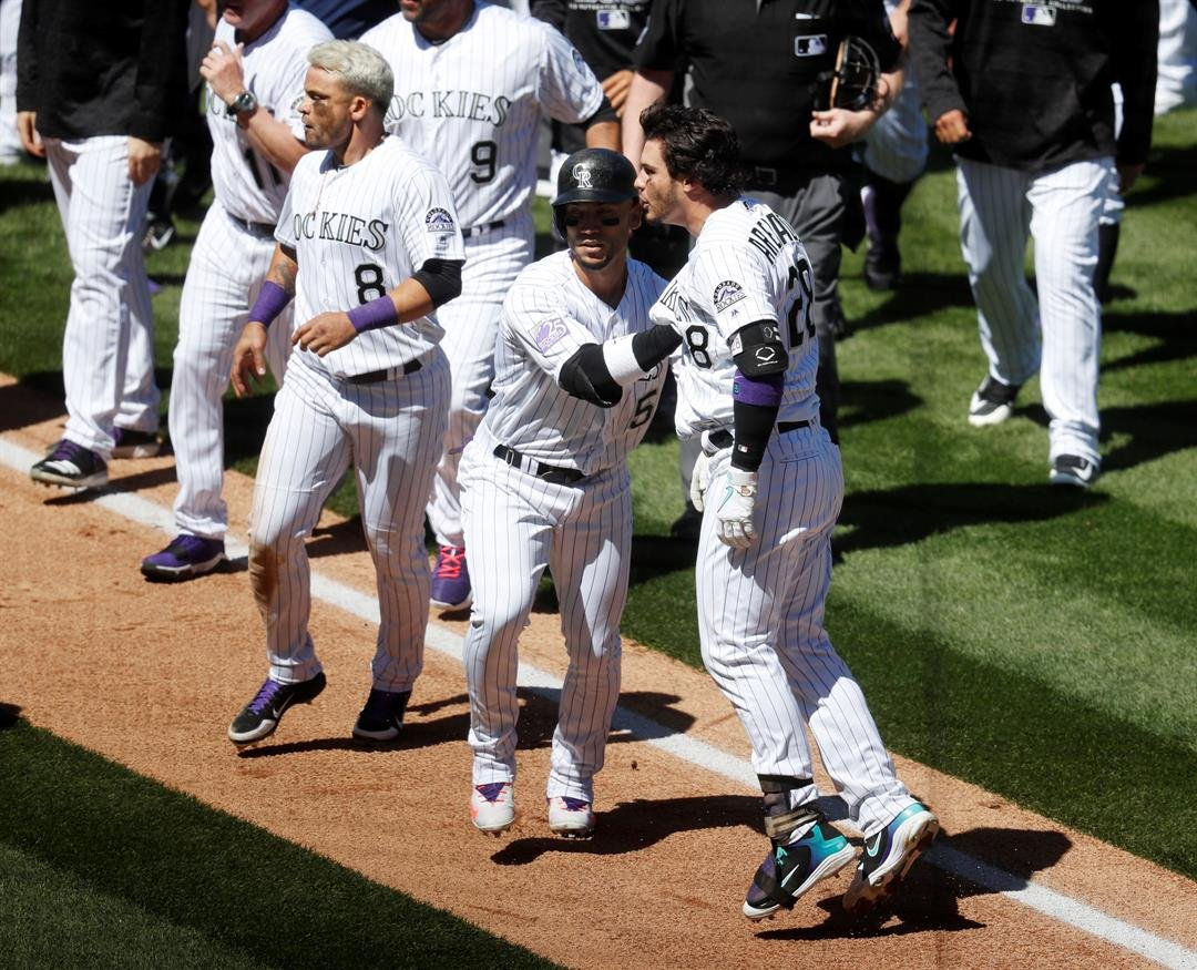 Suspensions handed down to Arenado, Parra in Coors Field brawl