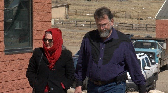 Torin and Rena Smith walk up to the Park County Courthouse