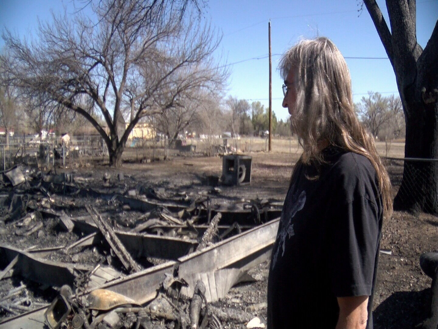 Steve Little stands in front of what used to be his mobile home on Barnett Road