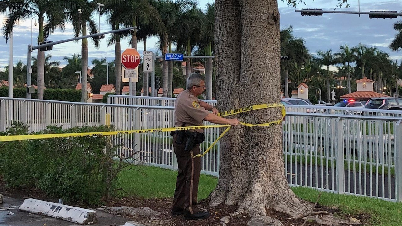Police tape off an area by the Trump National Doral resort after reports of a shooting inside the resort Friday, May 18, 2018 in Doral, Fla. (Associated Press)