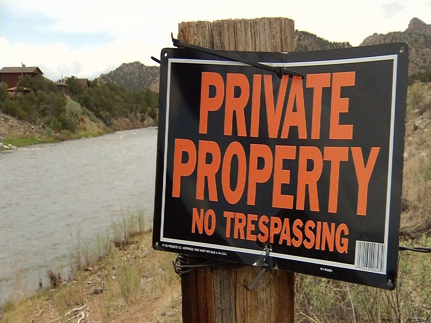 Signs posted along the banks of the Arkansas River in Fremont County declare the waterway to be private property