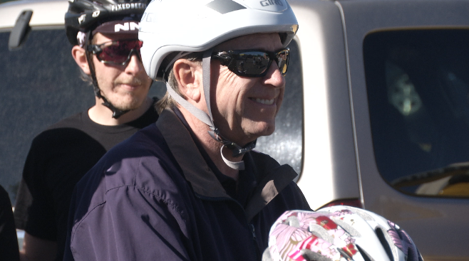 Mayor John Suhters grins as he gets ready for the community bike ride Saturday
