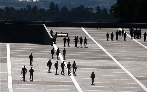 FILE: Cadets walk between classes on the Air Force Academy campus, near Colorado Springs, Colo., Wednesday Aug. 13, 2014. (AP Photo/Brennan Linsley)