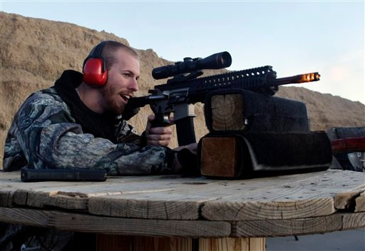 FILE - In this Dec. 23, 2012 file photo, Michael Reed, of Cedar Park, Texas, shoots an AR-15 rifle, at Dragonman's firing range and gun dealer, outside Colorado Springs, Colo.
