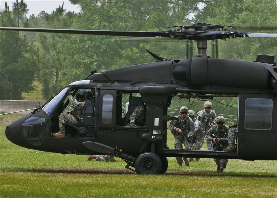 Rangers make their way to the UH-60 Blackhawk to exit the area during a scenario at the 6th Ranger Training Battalion's annual open house event, May 12 at Eglin Air Force Base, Fla. The event was a chance for the public to learn how Rangers train