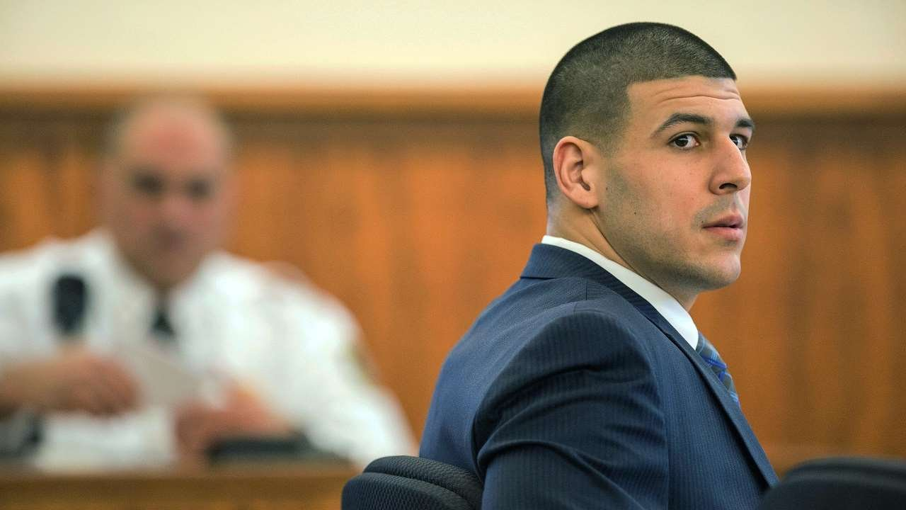 Former New England Patriots football player Aaron Hernandez, left, listen to testimony during his trial, Monday, March 9, 2015, at Bristol County Superior Court in Fall River, Ma.