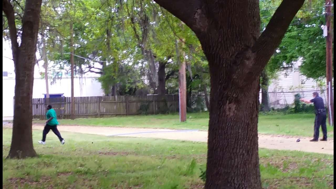 In this April 4, 2015, frame from video provided by Attorney L. Chris Stewart representing the family of Walter Lamer Scott, Scott appears to be running away from City Patrolman Michael Thomas Slager, right, in North Charleston, S.C.