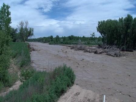 Eroded dirt levee along Fountain Creek near Dillon Drive in Pueblo