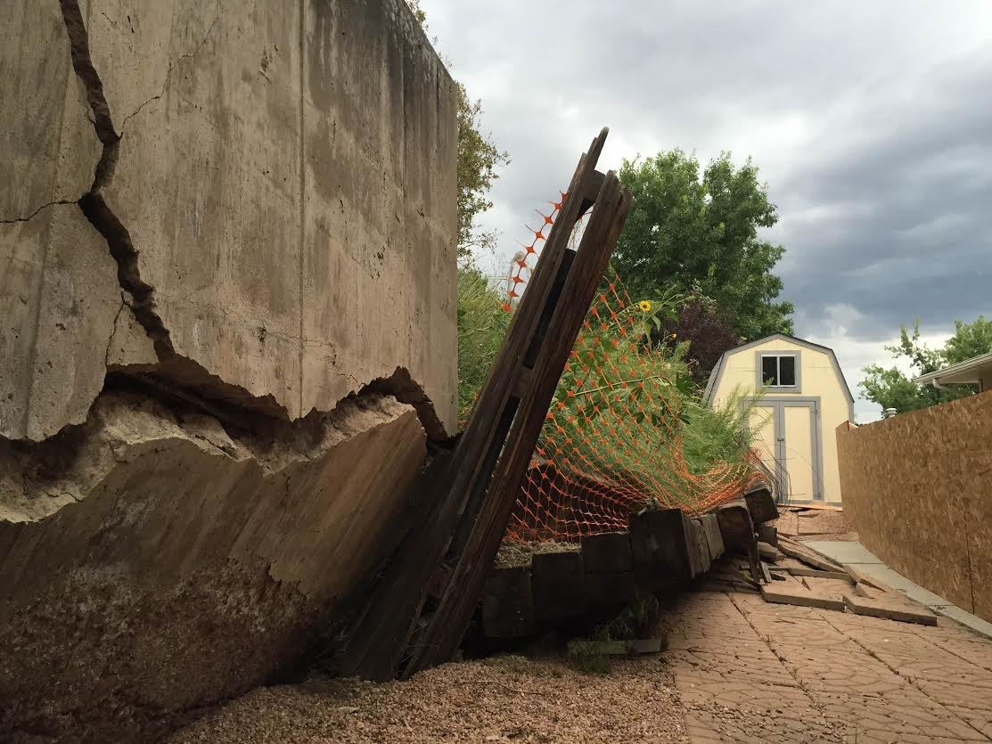 A retaining wall behind a home on Zodiac drive failed due to a landslide.