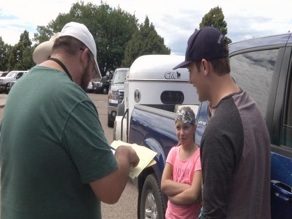 Veterinarians check paperwork on all livestock before they can enter state fairgrounds
